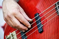 Playing electric bass guitar
