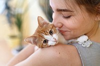 Happy young woman and red kitten