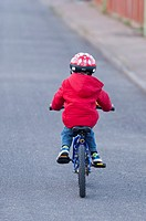 A three year old boy riding his bike on the first day with no stabilizers in the Uk