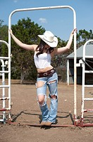 Sexy cowgirl posing on a ranch