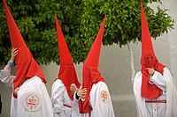 Penitents stand outside a church after an Easter Holy Week procession in Carmona village, Seville province, Andalusia, Spain, April 19, 2011