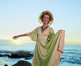 Sophisticated Senior Woman ´dances´ at seaside
