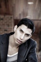 Hispanic young male posing at park