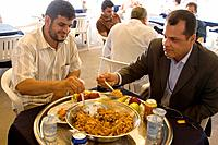 Tripoli, Libya  Muslim Wedding Celebrations  Wedding Lunch, Couscous, of lamb, semolina, onions, carrots  It is common on such occasions to eat from t...
