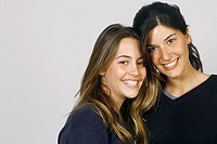 Studio shot of two young women, smiling
