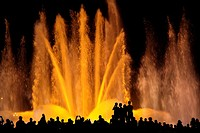 Tourists enjoying the light show of the Plaza de Espana in Barcelona, Catalonia, Spain