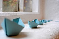 Row of paper boats