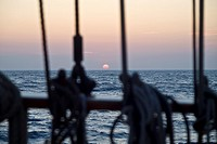 Sunset aboard of tall ship Thalassa, North Sea, Europe