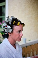 MEDEVI SWEDEN Bride to be has hair in rollers before the wedding.