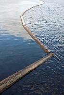 log boom barrier floating on water