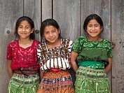 Three Guatemalan girls smiling for photo