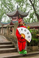 A dynasty warrior in ethnic dress welcomes guests to the city of Ghosts in Fengdu, China, Asia