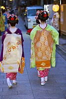 Two geisha walking back to their tea house in the Gion area of Kyoto