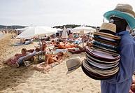 Bathers on the beach and people at the beach club at Plage de Pampelonne, Saint Tropez, Côte d´Azur, Var, Provence-Alpes-Côte d´Azur, France