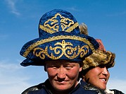Kazakh men wearing traditional hats to their heads.