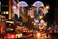 Colourful Christmas decorations in Oxford Street London UK