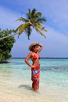 Girl watching the Ocean at the seashore, Biyadhoo island, Maldives