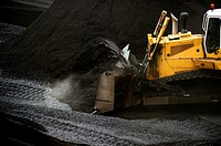 Excavator removing coal in a thermal power station