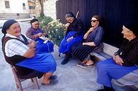 old women meeting in a street of Bansko, village of the Pirin Mountains, Bulgaria, Europe