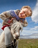 Girl with goat, Goat farm, Iceland
