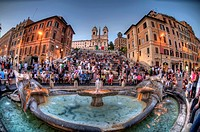 HDR Fisheye view of the The Spanish Steps with the Trinità dei Monti church at the top as seen from the Fontana della Barcaccia in the Piazza di Spagn...
