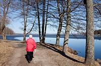 Elderly woman walking at shore  Location Asemanlahti Pieksämäki Finland Scandinavia Europe