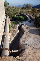 landscape irrigation canal and pipe in orchard, Alhama de Almeria, Andalucia, Spain, Europe
