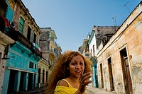 "A Cuban girl ""jinetera"" flirting with a foreigner on the street of Havana, Cuba, 11 August 2008  Many Cuban girls aware of their natural beauty offer ..."