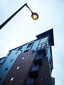 Modern apartments showing corner with balconies and street light in Liverpool, Merseyside, UK