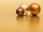 Christmas baubles on golden background