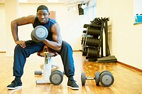 Tilburg, Netherlands  Young African-American man working out in the gym