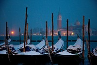 Moored gondolas covered with snow, St  Mark´s basin, Venice, Italy, Europe