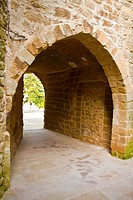 Dark street of Su  Popular style, thirteenth century   Small medieval street, covered with a vault  It has two arches, one input street semicircular s...