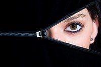 Female face hidden behind opening zipper, 18 years, Caucasian