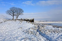 Top Withens Pennine Way in winter snow on Haworth Moor, Haworth, West Yorkshire, England, UK