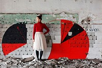 Young woman in abandoned ruins in Bucharest, Romania