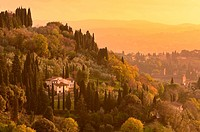 Typical tuscany´s landscape with rural home among tuscany´s trees