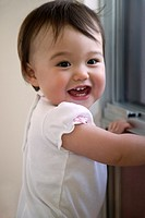 Smiling baby in front of a window