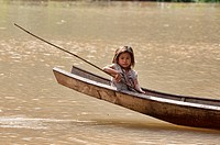Lanten girl in her dugout canoe on the Nam Ha River, Luang Nam Tha, Laos