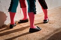 Legs of bullfighters waiting in the patio de cuadrillas, Jaen, Spain