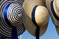 Straw hat for sale at a street market, on Santa Comba Dão, Portugal