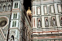 The Duomo and Belltower area at night in Florence Italy.