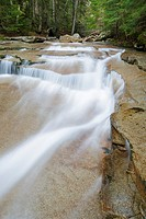 Walker Cascades during the spring months. These cascades are located along Walker Brook in Franconia Notch State Park of the White Mountain National F...