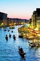Europe, Italy, Veneto, Venice, classified as World Heritage by UNESCO. Gondola in the Grand Canale at night.