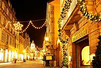 """""""""""""""""""""""Bartholdi"""""""" restaurant witn Christmas lights at the city center by night. Colmar. Wine route. Haut-Rhin. Alsace. France."""