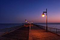 Boardwalk pier at night. Cape Helopen State Park, Delaware.