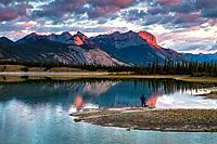 Photographer watching the sunrise over the Canadian Rocky Mountains in the Jasper National Park, Alberta, Canada