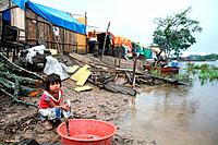 Young girl at a roadside camp on the outskirts of Trinidad badly effected by flooding, Beni, Bolivia, South America.