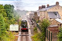 A steam train engine arrives at the Leyburn Station on the Wensleydale Railway in Leyburn , North Yorkshire, England, Britain, Uk.