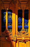 Madrid, Spain. Detail of yellow doors with blue iron work.